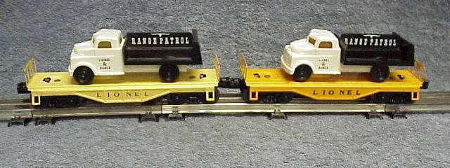 Photo of two 6151 Flatcars with Range Patrol Trucks